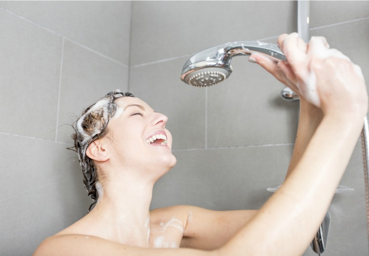 Woman Singing in the Shower - Soakology Blog